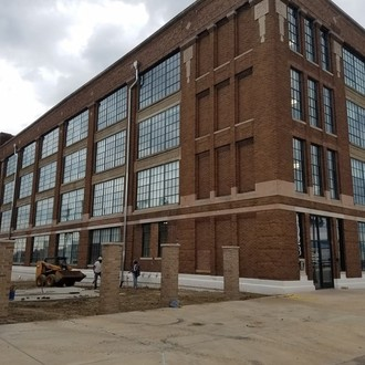 Protect buildings that contribute to the character of the Warehouse District