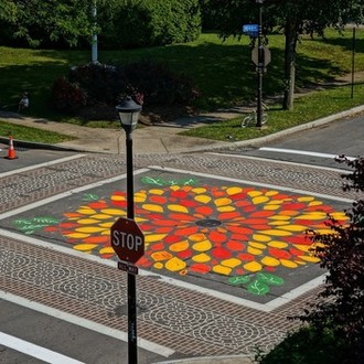 Add a street mural to Augusta & Harvey to make drivers more aware